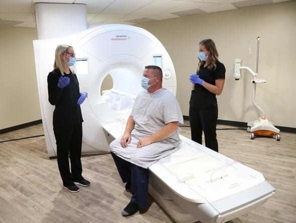 nurses-explaining-wide-bore-MRI-procedure-to-patient